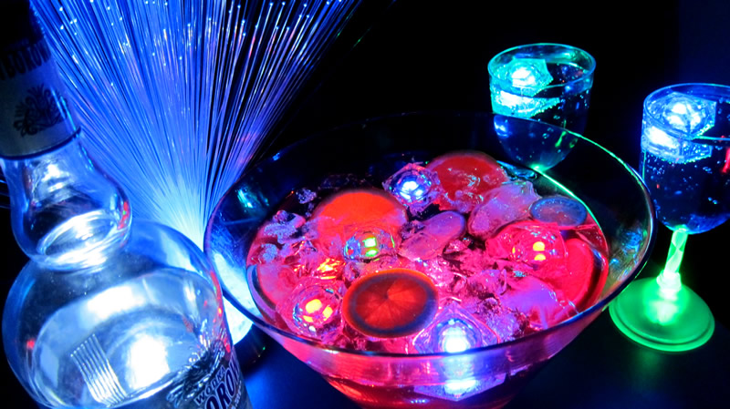 Glowing centerpieces other glow party highlights for Glow in the dark centerpiece ideas